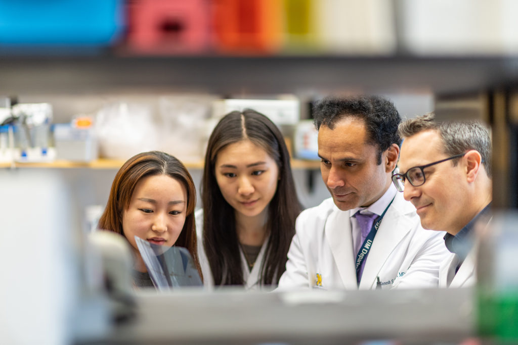 Dr. Ganesh Palapattu's Lab: Xiyuy Cao, Samantha Lee, Dr. Ganesh Palapattu, Chair and Faculty, and Dr. Alexander Zaslavsky, Faculty (left to right). Analyzing molecular data obtained from patient samples to develop new and better cancer treatments.