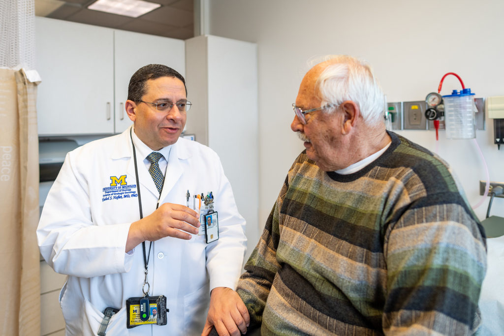 Dr. Khaled Hafez with Patient in Cancer Center Clinic